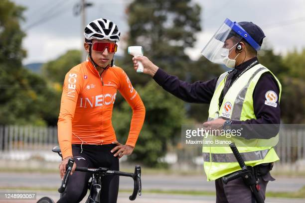 Pro cyclist Egan Bernal of Colombia and Team Ineos gets a temperature check while trainining in isolation at home during Covid-19 lockdown on June...