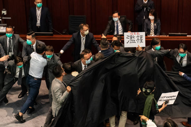 CHN: Lawmakers Scuffle In Hong Kong Against The National Anthem Bill