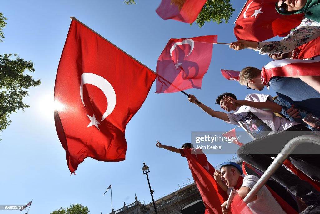 A Pro Erdogan supporter waves the Turkish flag outside Downing Street as Turkish President Recep Tayyip Erdogan meets the Prime Minister, on May 15, 2018 in London, England. Turkish President Mr Erdogan is in the UK for a three-day visit, which includes a closing lecture at the Tatlidil Forum in Oxford, an audience with The Queen and talks with British Prime Minister Theresa May.