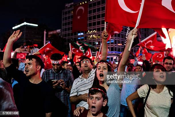 Pro Erdogan supporters shout slogans during a rally at Kizilay Square in Ankara on July 20 following the failed military coup attempt of July 15...