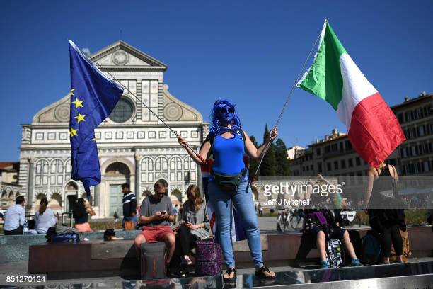A pro EU supporter holds an EU flag and an Italian flag prior to British Prime Minister Theresa May given her landmark Brexit speech in Complesso...