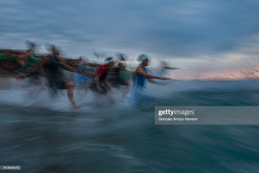 Pro female athletes start the swimming course of the Ironman Barcelona on October 2, 2016 in Calella, Spain.