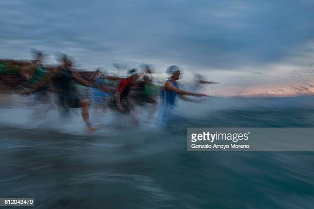 Pro female athletes start the swimming course of the Ironman Barcelona on October 2 2016 in Calella Spain