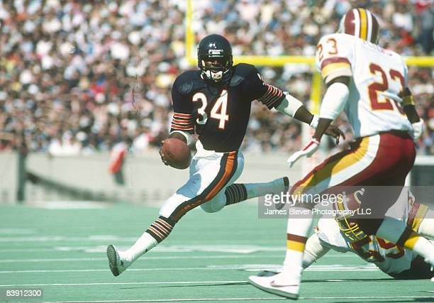 Pro Football Hall of Fame and Chicago Bears running back Walter Payton breaking tackles in the Bears 4510 victory over the Washington Redskins on...