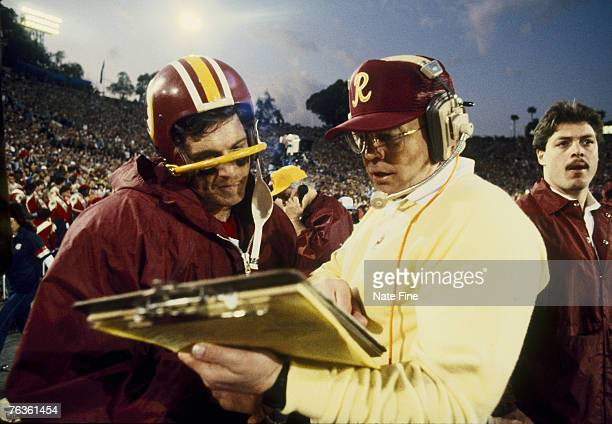 Pro Football Hall of Fame and Washington Redskins head coach Joe Gibbs discussing a play with Wahington quarterback Joe Theismman during the 4th...