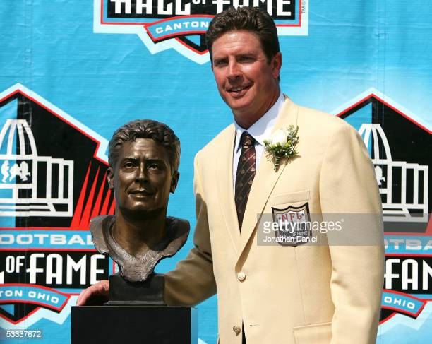 Pro Football Hall of Fame enshrinee Dan Marino of the Miami Dolphins poses with his bust during the 2005 NFL Hall of Fame enshrinement ceremony on...