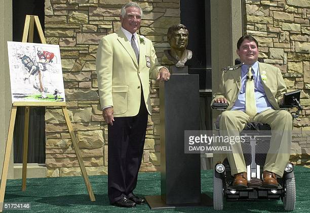 Pro Football Hall of Fame enshrinee Nick Buoniconti and his son and presenter Marc Buoniconti pose with Nick's bust during the enshrinement ceremony...