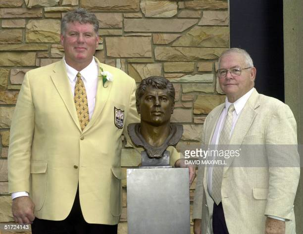 Pro Football Hall of Fame enshrinee Ron Yary stands with his presenter Minnesota Vikings assistant coach John Michels during the enshrinement...