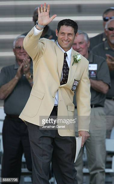 Pro Football Hall of Fame enshrinee Steve Young of the San Francisco 49ers waves to the crowd during the 2005 NFL Hall of Fame enshrinement ceremony...