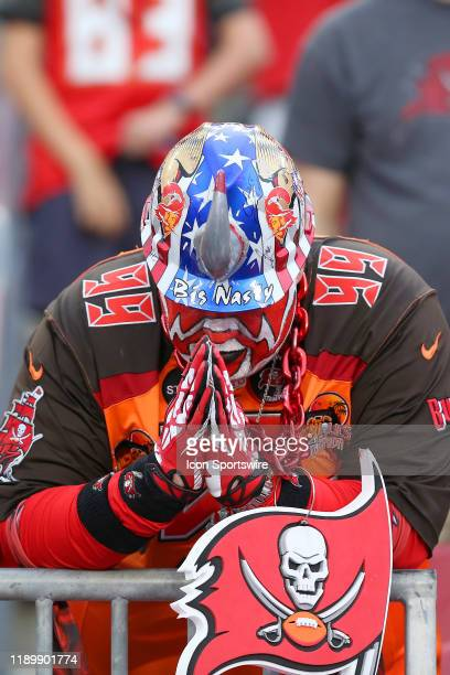 Pro Football Hall of Fame fan Big Nasty aka Keith Kunzig says a prayer while the Bucs are on defense during the regular season game between the...