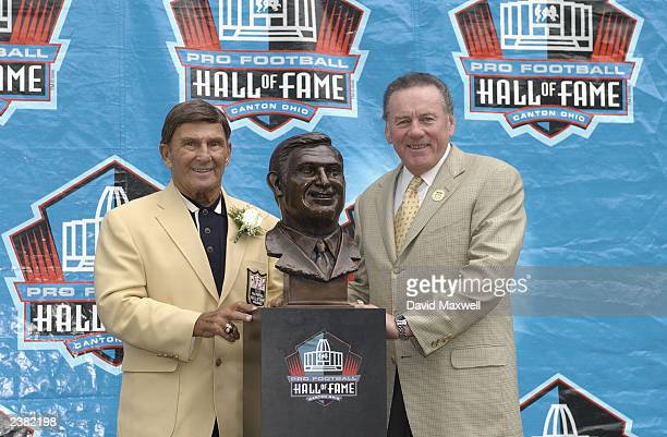 Pro Football Hall of Fame inductee Hank Stram poses with his bust and his presenter and fellow Hall of Famer Len Dawson during the 2003 NFL Hall of...