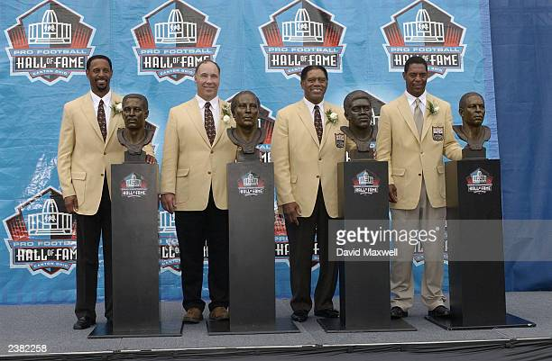 Pro Football Hall of Fame inductees James Lofton Joe DeLamiellure Elvin Betha and Marcus Allen pose with their busts during the 2003 NFL Hall of Fame...