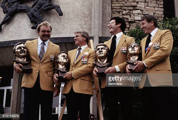 Pro football Hall of Fame inductees pose on the steps of the Hall of Fame. From left to right are Dick Butkus, Yale Lary, Ron Mix and Johnny Unitas.