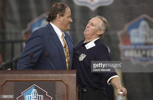 Pro Football Hall of Fame member Tommy McDonald thumps chests with ESPN announcer Chris Berman during the 2003 NFL Hall of Fame Induction ceremony on...