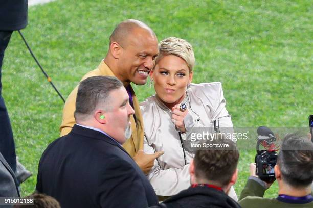 Pro Football Hall of Famer Aeneas Williams poses for a photo with Pink as she wears his Super Bowl Ring after singing the National Anthem prior to...