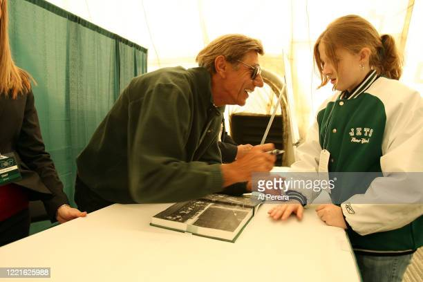Pro Football Hall of Famer and New York Jets alumni Joe Namath signs copies of the book Joe Namath when he attends the New York Jets vs Houston...