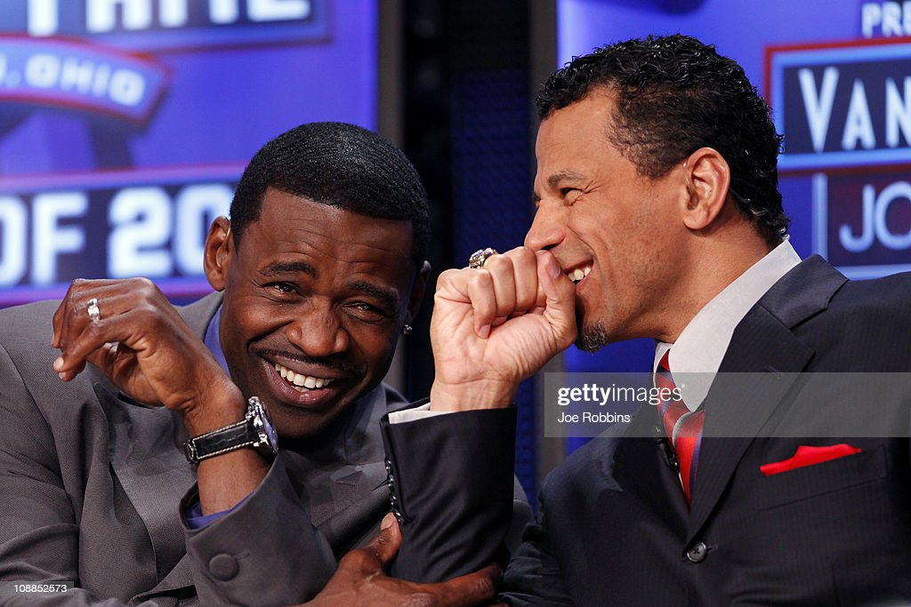 Pro Football Hall of Famers Michael Irvin and Rod Woodson share a laugh on the NFL Network set prior to the announcement of the 2011 Pro Football Hall of Fame class at the Super Bowl XLV media center on February 5, 2011 in Dallas, Texas.