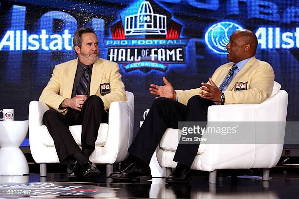 Pro Football Hall of Famers Warren Moon and Dan Fouts speak during the Pro Football Hall of Fame News Conference at the JW Marriott on February 4...