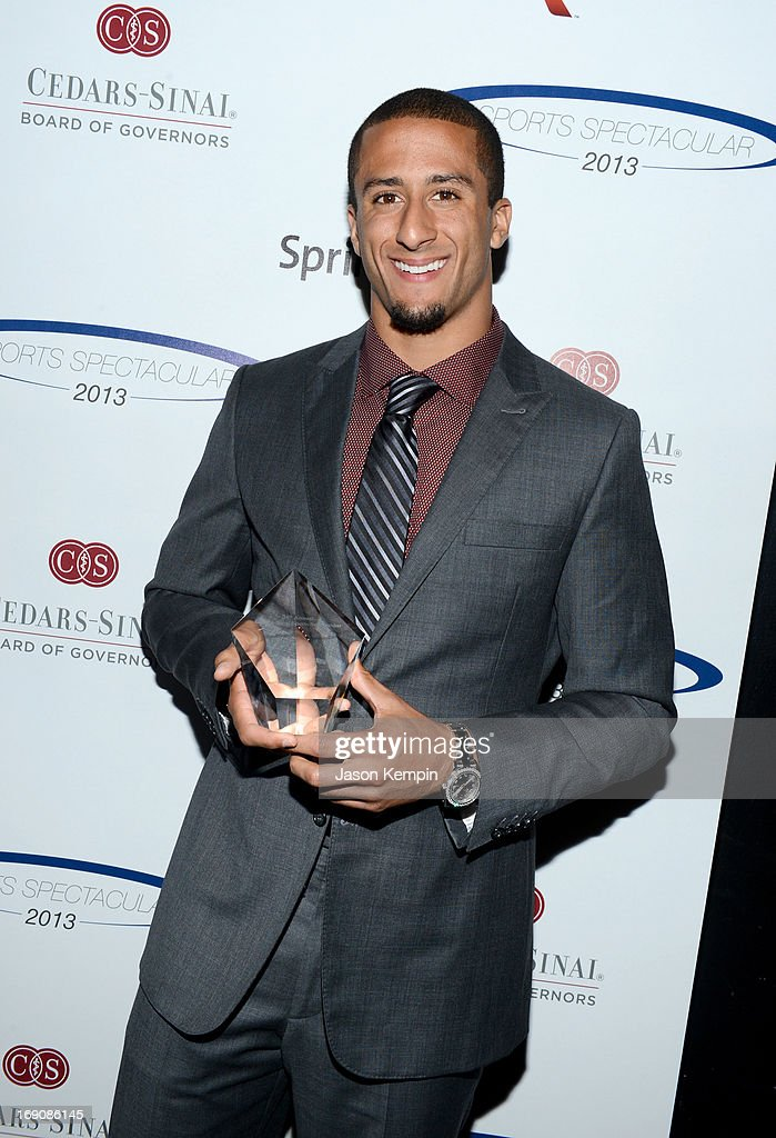 Pro football player Colin Kaepernick poses with the Breakout Player of the Year Award at the 28th Anniversary Sports Spectacular Gala at the Hyatt Regency Century Plaza on May 19, 2013 in Century City, California.