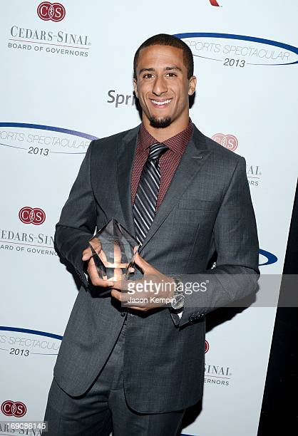 Pro football player Colin Kaepernick poses with the Breakout Player of the Year Award at the 28th Anniversary Sports Spectacular Gala at the Hyatt...