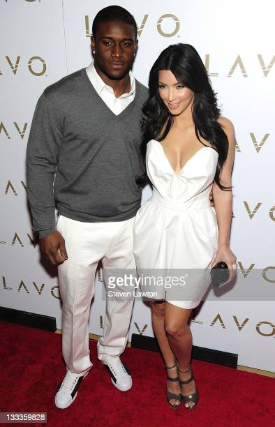 "Pro football player Reggie Bush and television personality Kim Kardashian arrive for ""Queen Of Hearts"" ball at Lavo Restaurant & Nightclub at The..."