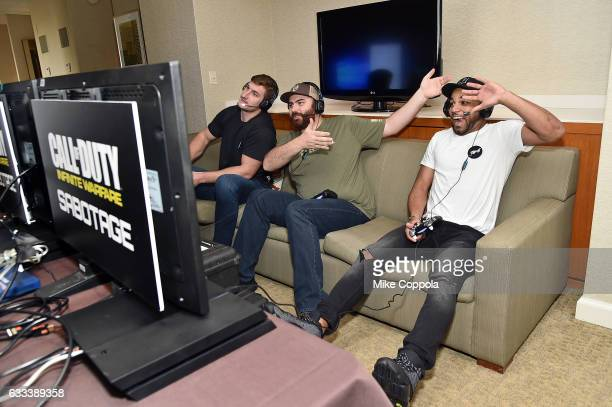 Pro football players Golden Tate and Joey Bosa play Call of Duty Infinite Warfare Sabotage DLC with Hike the Gamer on February 1 2017 in Houston Texas