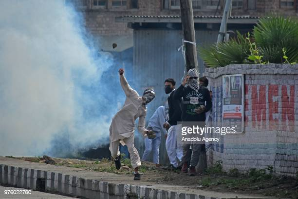 A pro freedom protester throws stone during anti India clashes between Indian paramilitary soldiers and protesters after Eid alFitr prayer on the Eid...