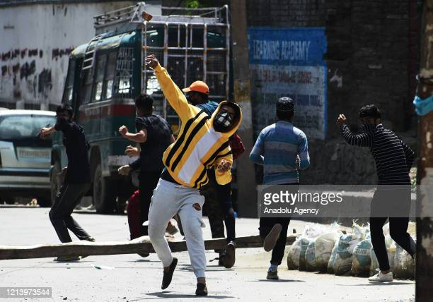 Pro freedom protesters clash with Indian police in old city Srinagar Kashmir where two militants were killed on May 19 2020Director General of JK...