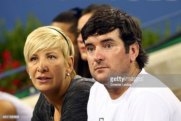 Pro Golfer Bubba Watson and his wife Angie Watson watch as Diego Schwartzman of Argentina plays against Novak Djokovic of Serbia during their men's...