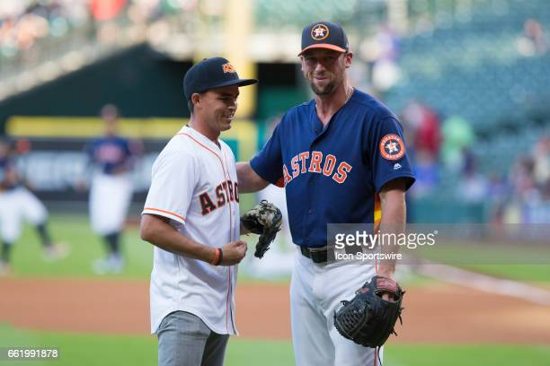 Pro golfer Rickie Fowler pose with a photo with Houston Astros relief pitcher Luke Gregerson after throwing the first pitch before the start of an...
