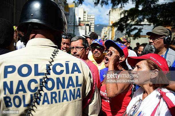 Pro government activists chant slogans during the installation of the new parliament in Caracas on January 5 2016 Venezuela's President Nicolas...