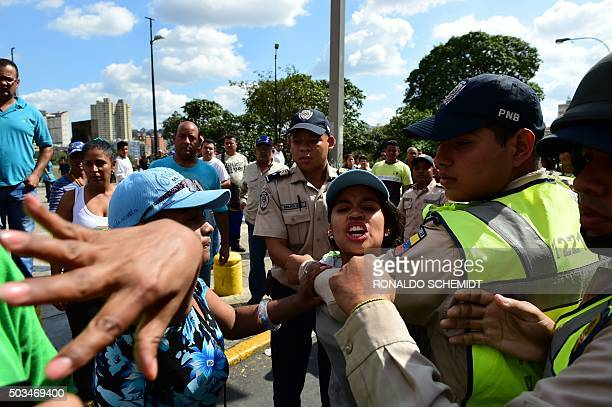 Pro government activists struggle with police during the installation of the new parliament in Caracas on January 5 2016 Venezuela's President...