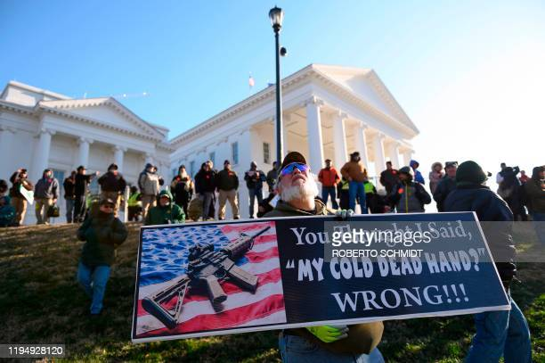 A pro gun supporter holds a sign while waiting in the grounds of the Virginia State Capitol for a rally to begin in Richmond Virginia on January 20...