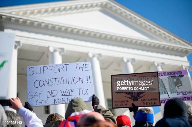 Pro gun supporters gather in front of the Virginia State Capitol during a gun rights rally in Richmond Virginia on January 20 2020 Several thousand...