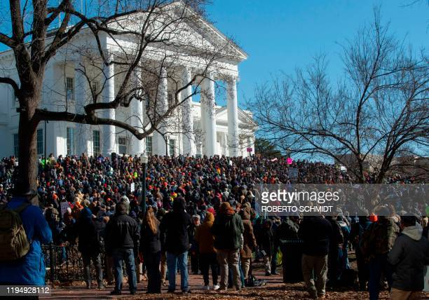 Pro gun supporters gather on the grounds of the Virginia State Capitol in Richmond Virginia on January 20 2020 Several thousand gun rights supporters...