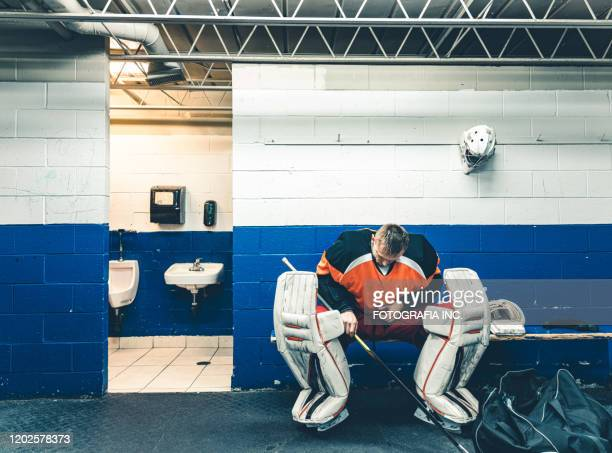 pro hockey goalie after the training - ice hockey uniform stock pictures, royalty-free photos & images