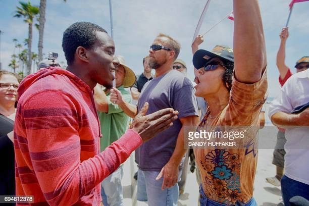 Pro immigrant rights supporter Kareem Samuel argues with an anti Shariah Law supporter during the March For Human rights and Against Sharia law...