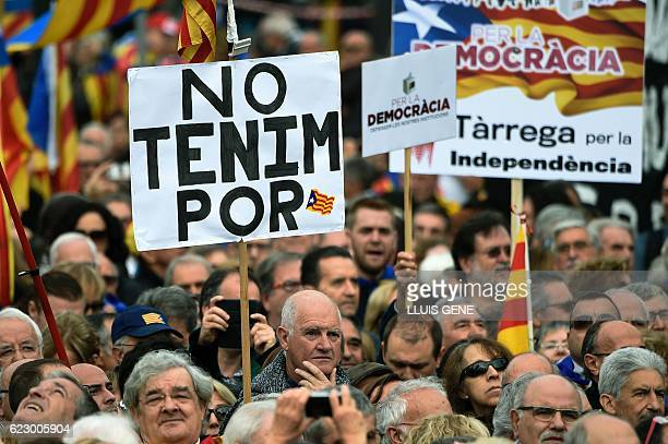 """Pro independence demonstrators hold a banner reading """"We are not afraid"""" during a demonstration organized by ANC , AMI and Omnium Cultural, against..."""