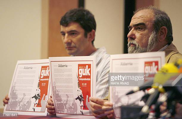 Pro independence political party Basque Nationalist ActionANV leader Kepa Bereziartua and other ANV representatives show copies of ANV's manifiesto...