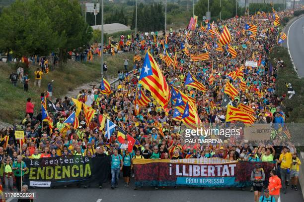 Pro independence protesters march in San Vicenc dels Horts, on October 18 on the day that separatists have called a general strike and a mass rally....