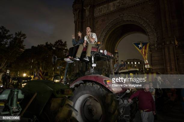 Pro independence supporters react after Catalan President Carles Puigdemont announced he will abide by the independence vote as they watch on big...