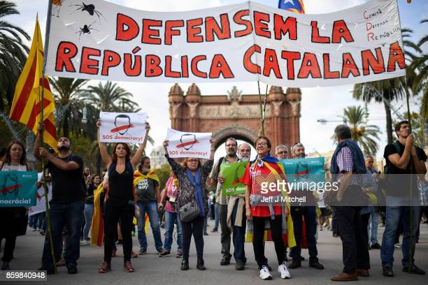 Pro independence supporters wait outside the Parliament of Catalunya to hear the address of Catalan President Carles Puigdemont on October 10 2017 in...