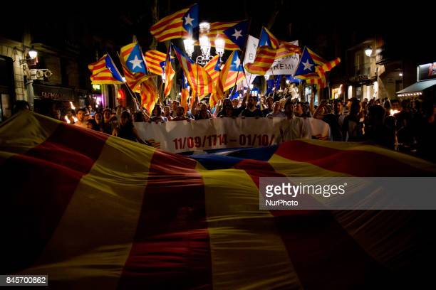 Pro independentist supporters wave estelada flags the eve of La Diada or Catalan National Day on Sept 10 in Barcelona Spain