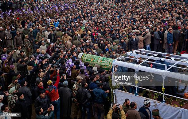 Pro Indian politician and supporters carry the casket bearing the body of pro Indian Jammu and Kashmir Chief Minister Mufti Mohammad Sayeed during...