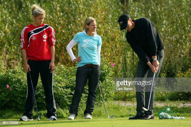 Pro Kari Jarvinpaa explains Bianca Schmidt and Martina Mueller a chip during a German National Team golf session at Tammer Golfclub on August 29 2009...