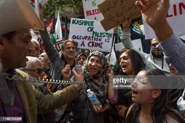 Pro Kashmir demonstrators speak into a megaphone outside India's diplomatic mission on August 15, 2019 in London, England. India has stripped Kashmir...