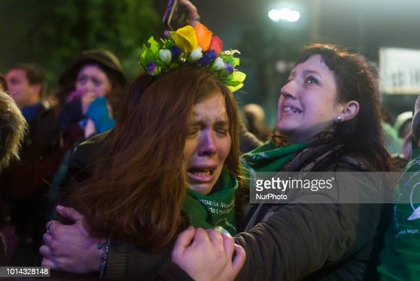 A Pro legal abortion activist cries after senators rejected the bill to legalize abortion in Buenos Aires on August 9 2018 Argentine senators on...