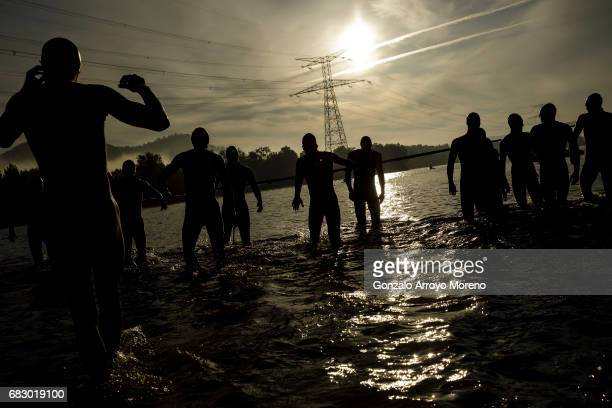 Pro male athletes enter to the water prior to start the swimming course of the Ironman 703 Pays d'Aix on May 14 2017 at Lake Peyrolles France