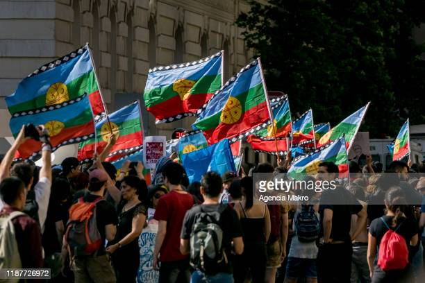 Pro Mapuche demonstrators wave Wenufoye flags in a ceremony iat Plaza de Armas during a protest against president Sebastian Piñera to commemorate the...