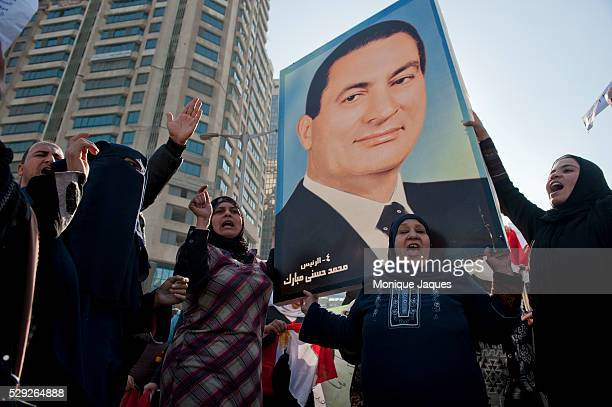 A Pro Mubarak rally in the affluent neighberhood of Zamalek Cairo attended by thousands of supporters After the Janurary 25th revolution protesters...